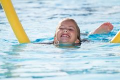Child in blue water of the swimming pool. Girl, happiness. Girl child in blue water of the swimming pool Stock Image