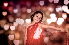 Girl child bride in red saree Royalty Free Stock Photo