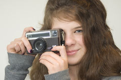 Girl child with camera. 10 year old smiling girl with a camera Royalty Free Stock Photography
