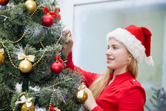 Girl child of about the Christmas tree on Christmas Eve Stock Photo