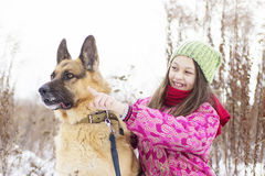 Girl child and dog Shepherd Royalty Free Stock Photography