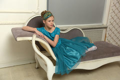 The girl child in the glamorous dress stock photo