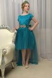 The girl child in the glamorous dress. Aqua stock photo