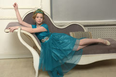 The girl child in the glamorous dress Stock Photos