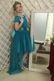 The girl child in the glamorous dress standing next to the mirror, admiring herself Royalty Free Stock Photography