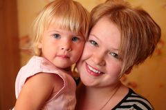 Girl with  child on hands Stock Photos