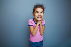 The girl child is happy surprise on gray Stock Images