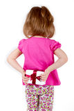 Girl child hid behind a gift Royalty Free Stock Photo