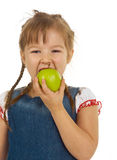 Girl child holding an apple Stock Photos