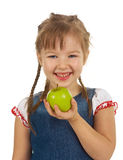 Girl child holding an apple Royalty Free Stock Photos