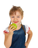 Girl child holding an apple Stock Images
