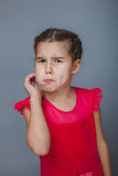 Girl child holding hands at the mouth toothache on Royalty Free Stock Images
