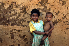 Girl child in India. June 02,2011 Rampurhut,Birbhum,West Bengal,India,Asia- A tribal girl holding her brother in a village of West Bengal Royalty Free Stock Photography
