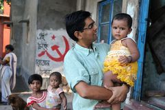 Girl Child in India. June 12,2012 Kolkata,West Bengal,India,Asia-A man holding a little girl at the slum area of Kolkata Stock Photos