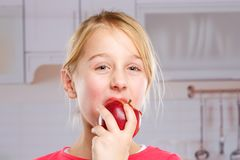 Girl child kid eating apple fruit autumn fall healthy Royalty Free Stock Photography