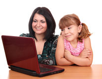 Girl and child with laptop Stock Images
