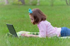 Girl child with laptop outdoors stock photos