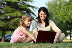 Girl and child with laptop Royalty Free Stock Images