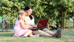 Girl and child with laptop Royalty Free Stock Image