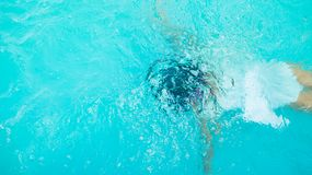 Girl child learning swimming on summer. Girl child learning swimming and diving on summer holidays Royalty Free Stock Image