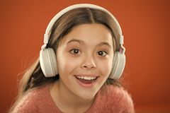 Girl child listen music modern headphones close up. Get music subscription. Access to millions of songs. Enjoy music royalty free stock image