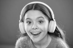 Girl child listen music modern headphones close up. Get music subscription. Access to millions of songs. Enjoy music. Concept. Best music apps that deserve a stock photos