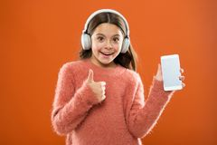 Girl child listen music modern headphones and smartphone. Get music family subscription. Access to millions of songs stock images