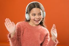 Girl child listen music modern wireless headphones. Listen for free. Get music account subscription. Access to millions. Songs. Enjoy music concept. Keep hands stock image