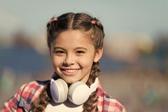 Girl child listen music outdoors with modern headphones. Music account playlist. Customize your music. Discovering new stock photos