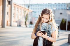 Girl child listen to the music from her smartphone Stock Photography