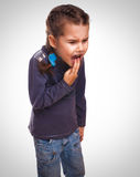 Girl child little vomits burps poisoning and Stock Image