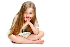 Girl child with long blond hair siting on a floor.fashion portr. Ait isolated on white background Royalty Free Stock Photo