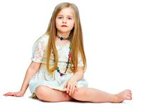 Girl child with long blond hair siting on a floor.fashion portr. Ait isolated on white background Stock Photography