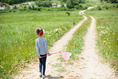 Girl, child, net, lifestyle, summer, forest, insects, joy, environment, nature. Girl with a butterfly net is on the trail royalty free stock photo