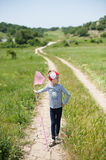 Girl, child, net, lifestyle, summer, forest, insects, joy, environment, nature. Child with a butterfly net is on the trail royalty free stock images