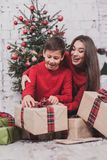 Girl and child new year with presents in hands royalty free stock photography