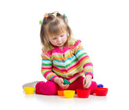 Girl child playing with cup toys Royalty Free Stock Photography