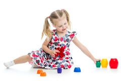 Girl child playing with cup toys Stock Image