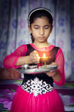 Girl child portrait holding prayer plate Royalty Free Stock Photo