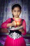 Girl child portrait holding prayer plate Royalty Free Stock Photo