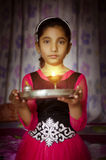 Girl child portrait holding prayer plate welcoming Royalty Free Stock Images
