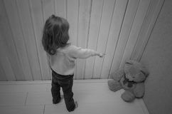 Punishes, puts in the corner of the toy bear girl, child. Girl, child punishes, puts in the corner of the toy bear Stock Photography