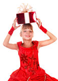 Girl child  in red dress with gift box. Stock Photo