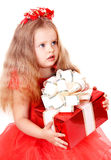 Girl child in red dress with gift box. Royalty Free Stock Images