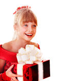 Girl child in red dress with gift box. Stock Images