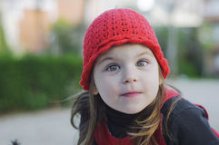 Girl child in red hat with a cheerful look Stock Photo