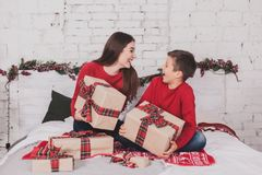 Girl and child new year with presents in hands Stock Photo