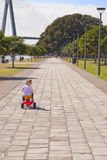 Girl child riding kids trike on path Royalty Free Stock Photo