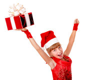 Girl child santa clause in red dress, gift box. Royalty Free Stock Images