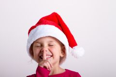 Girl child in santa hat portrait on white isolated, royalty free stock photo